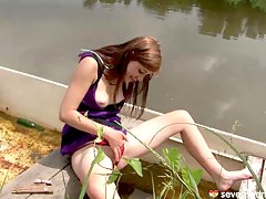 Brunette teen playing pussy on the boat