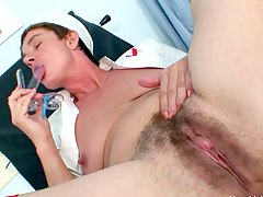 brunette granny nurse masturbating with a long dildo Libuse