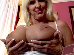 huge boobs mature blonde taunting us with her jugs Tia Gunn