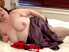chubby mature lady masturbating right on her bed Debbie X